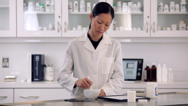 ws pharmacist grinding pills for compounding prescription medication / richmond, virginia, usa - mortar and pestle stock videos and b-roll footage