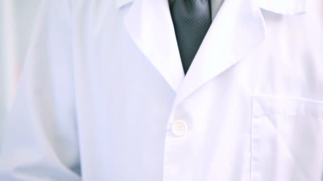 pharmacist holding a prescription while typing on a computer - lab coat stock videos & royalty-free footage