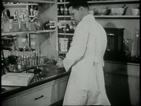 1946 - pharmacist in laboratory - prelinger stock videos & royalty-free footage