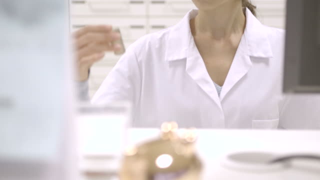pharmacist in pharmacy - drawer stock videos & royalty-free footage