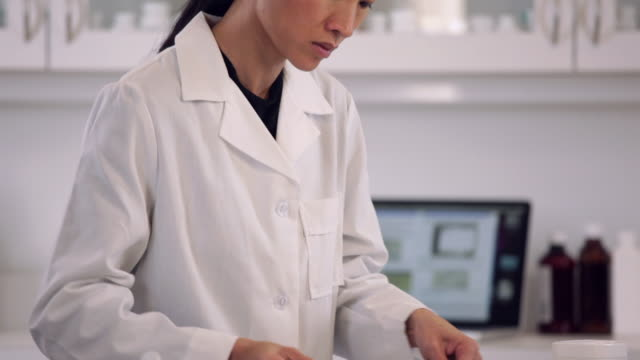 ms tu td pharmacist mixing powdered medication into petroleum jelly for compounding prescription / richmond, virginia, usa - mortar and pestle stock videos and b-roll footage