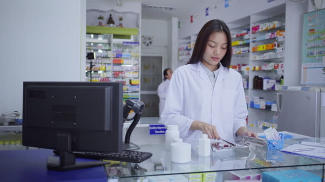 pharmacist pill counting - prescription medicine bottles stock videos & royalty-free footage