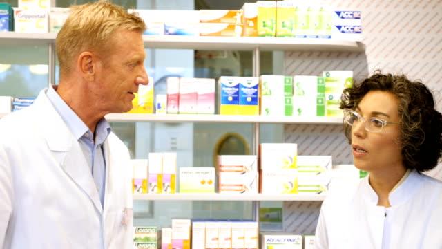 pharmacist talking to customer at pharmacy - money back guarantee stock videos & royalty-free footage