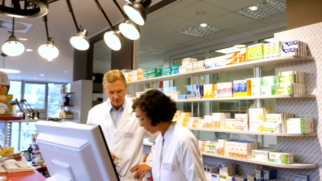 pharmacist talking to customer over prescription - receiving stock videos & royalty-free footage