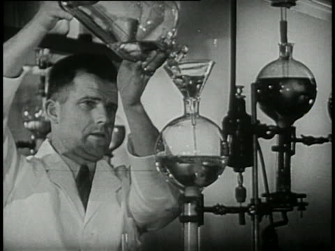 stockvideo's en b-roll-footage met 1946 - pharmacists working in laboratory - prelinger archief