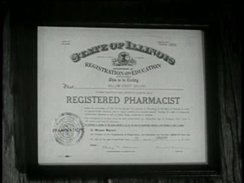 1946 - pharmacy degree, pharmacist wrapping drug bottle in paper - pill bottle stock videos & royalty-free footage