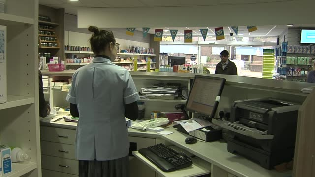 pharmacy general views; england: london: int general views pharmacy store / customers / medicines on display / staff chatting behind prescriptions... - prescription medicine stock videos & royalty-free footage