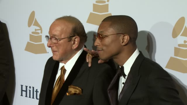 pharrell williams and clive davis at the pregrammy gala and salute to industry icons honoring martin bandier at the beverly hilton hotel on february... - the beverly hilton hotel stock videos & royalty-free footage