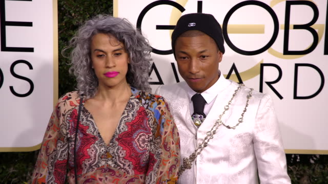 pharrell williams and mimi valdes at 74th annual golden globe awards arrivals at 74th annual golden globe awards arrivals at the beverly hilton hotel... - ビバリーヒルトンホテル点の映像素材/bロール