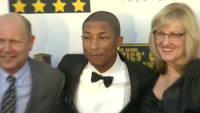 pharrell williams at 19th annual critics' choice movie awards - arrivals at the barker hanger on in santa monica, california. - critics' choice movie awards stock videos & royalty-free footage