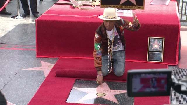 pharrell williams honored with a star on the hollywood walk of fame at hollywood walk of fame on december 04 2014 in hollywood california - 2014 stock videos & royalty-free footage