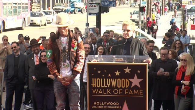 clean pharrell williams honored with a star on the hollywood walk of fame at hollywood walk of fame on december 04 2014 in hollywood california - bearbeitetes segment stock-videos und b-roll-filmmaterial