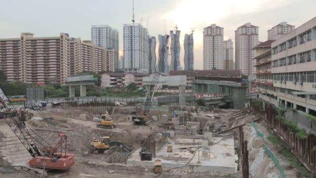 Phase 2 of the DutaUlu Kelang Expressway and the Ekovest Bhd Ekotitiwangsa residential development stand under construction in Kuala Lumpur Malaysia...