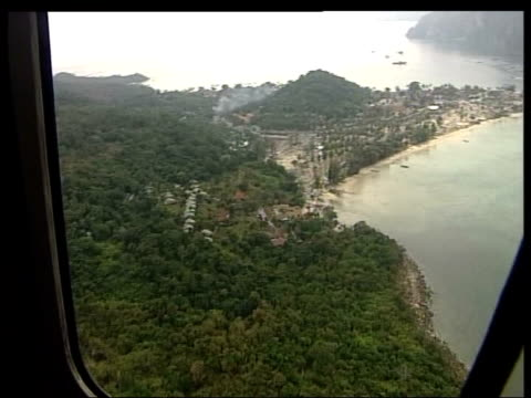 aftermath of tsunami in narrow strip of land joining two islands together showing devestation of tourist resort complexes ls soldier wearing white... - 2004 stock-videos und b-roll-filmmaterial