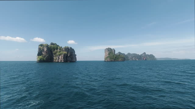phi phi islands transition from sea to islands 4k - swish pan stock videos & royalty-free footage