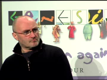 phil collins and mike rutherford on the cost of the tickets for the tour at the announcement of genesis 'turn it on again' tour dates at providence... - マイク ラザーフォード点の映像素材/bロール