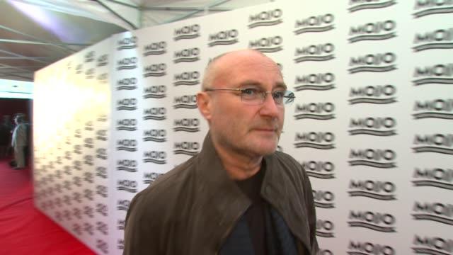 vídeos de stock, filmes e b-roll de phil collins at the mojo honours list at london . - phil collins