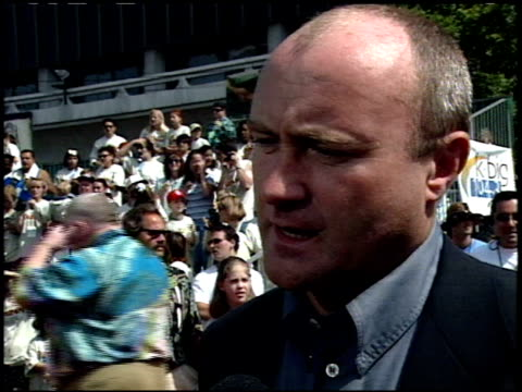 phil collins at the 'tarzan' premiere at the el capitan theatre in hollywood, california on june 12, 1999. - phil collins stock videos & royalty-free footage