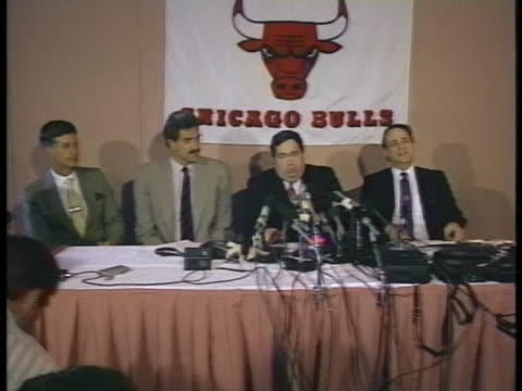 phil jackson holds a press conference after being named coach of the chicago bulls basketball team. - phil jackson stock videos & royalty-free footage
