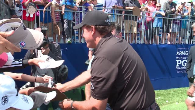 phil mickelson signs autograph for fans at a 2017 kpmg women's pga championship skills demonstration on june 26, 2017. - pga stock videos & royalty-free footage
