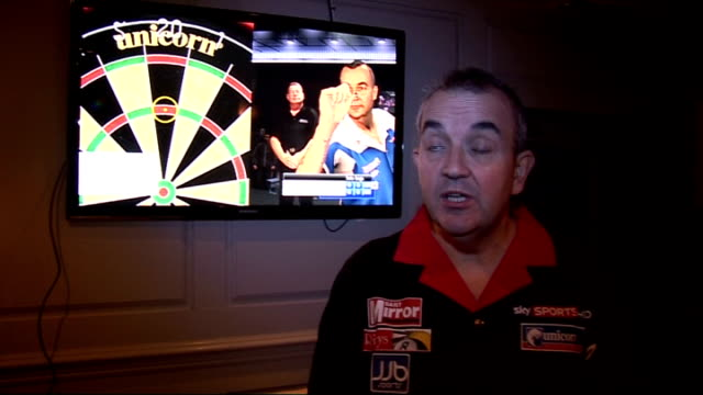 phil 'the power' taylor interviewed at launch of new computer game; england: london: int phil taylor interview sot - asked whether he's the world's... - take that stock videos & royalty-free footage