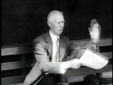 vídeos y material grabado en eventos de stock de philadelphia a's manager connie mack in dugout gesturing and holding papers / united states - 1957