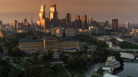 aerial philadelphia museum of art with center city shining in the rising sun in the background - philadelphia pennsylvania stock videos & royalty-free footage