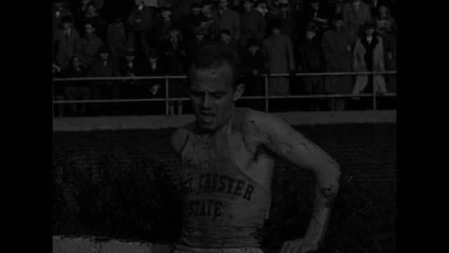 3000 meter steeplechase starts with bang of starter pistol men jump barricade across water barrier / muddy Alfred Knapp wins Penn Relay steeplechase...