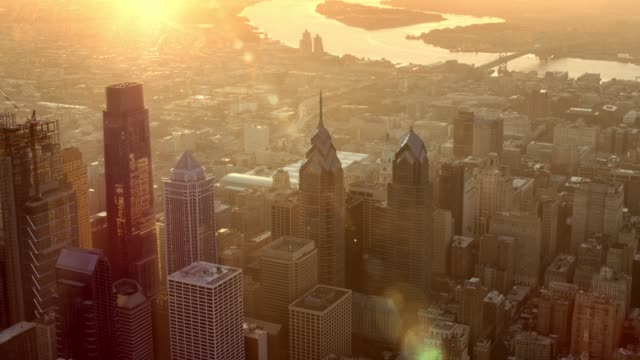 aerial philadelphia, pa lit by rising sun - philadelphia pennsylvania video stock e b–roll