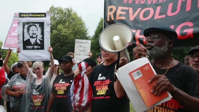 philadelphia, pennsylvania, usa: members of the revolutionary communist party speak after burning an american flag near the entrance to wells fargo... - communist flag stock videos & royalty-free footage