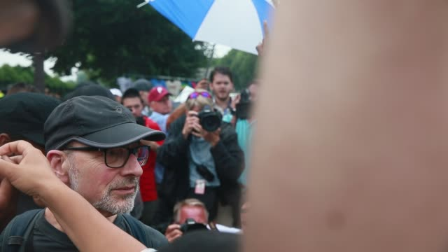 07282016 philadelphia pennsylvania usa trump supporter lawrence peyton right argues with members of the revolutionary communist party who burned a... - communist flag stock videos and b-roll footage