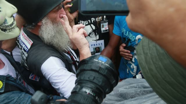 07282016 Philadelphia Pennsylvania USA Trump supporter Lawrence Peyton right argues with members of the Revolutionary Communist Party who burned a...