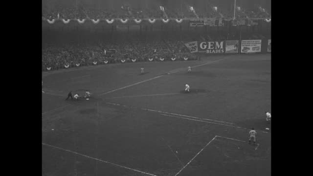 philadelphia phillies pitcher kirby higbe / new york giants players in dugout / giants pitcher carl hubbell / vs aerials / home run by phillies' gus... - philadelphia phillies stock-videos und b-roll-filmmaterial