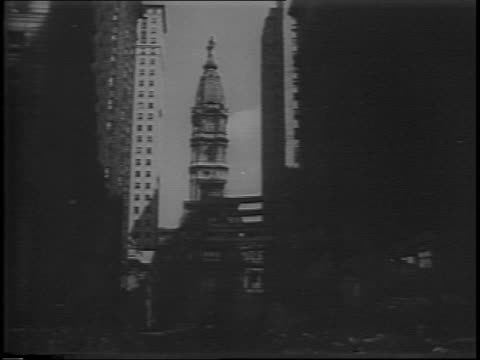 philadelphia street with crowds and thomas dewey's motorcade / montage of dewey motorcade dewey waving onlookers / massive crowds stage as dewey... - anno 1944 video stock e b–roll