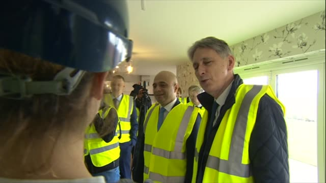 Philip Hammd and Sajid Javid tour Leicester housebuilding site ENGLAND Leicester Glebelands Park EXT GV site / site flags / ground clearing work in...