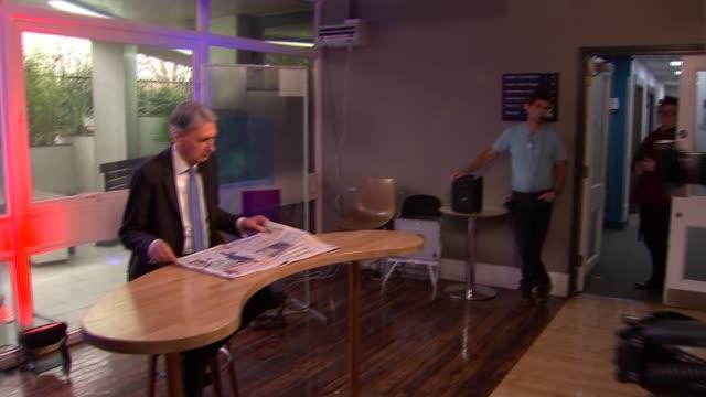 philip hammond bbc arrival / 'peston on sunday' interiors; england: london: bbc broadcasting house: ext philip hammond mp along arriving at bbc south... - talk show stock videos & royalty-free footage