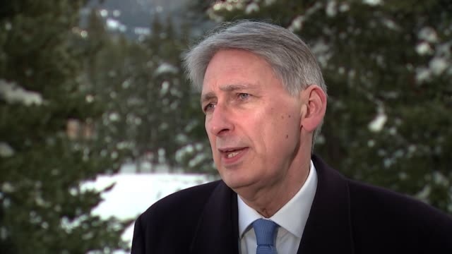 Philip Hammond interview in Davos SWITZERLAND Davos EXT Philip Hammond MP interview SOT on GDP / Brexit / Davos Philip Hammond MP along in 'golf...
