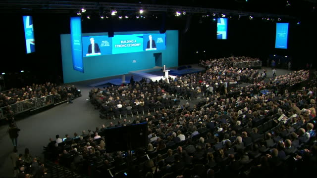 Philip Hammond saying Jeremy Corbyn and the Labour party is a 'clear and present danger to Britain's prosperity' at the Conservative Party conference