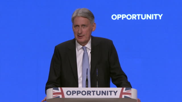 philip hammond saying the conservative party is and always will be the party of business during his speech at the party conference - フィリップ ハモンド点の映像素材/bロール