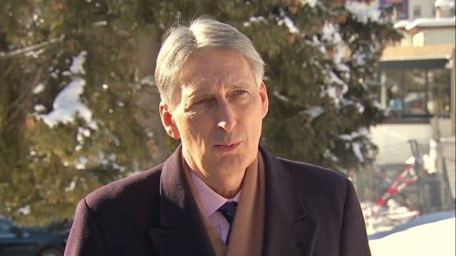 philip hammond uk chancellor of the exchequer attended a plenary session at the world economic forum in davos on its final day interview grab with... - chancellor of the exchequer stock videos and b-roll footage