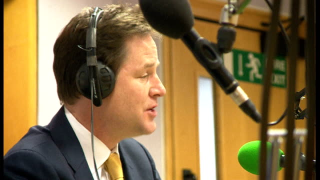 philip hammond warns against further defence spending cuts lib southampton int various shots of nick clegg mp being interviewed on bbc radio solent - southampton hampshire stock-videos und b-roll-filmmaterial