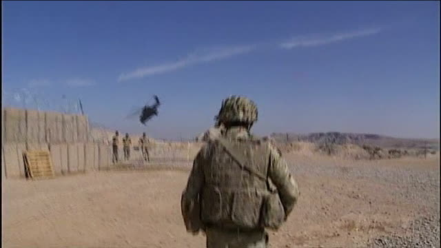 Philip Hammond warns against further defence spending cuts T07021328 / TX Helmand Province Camp Bastion SHOT following troop with helicopter flying...