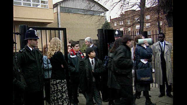 widow's reaction to killer remaining in uk tx december 1995 police and school children outside school gates children leaving floral tributes end lib - widow stock videos & royalty-free footage