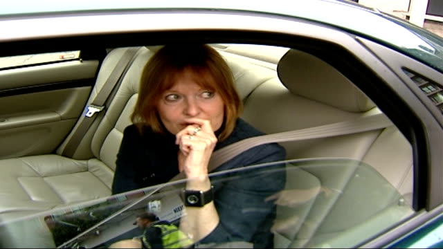 widow's reaction to killer remaining in uk frances lawrence laughing and chatting as sitting in car - widow stock videos & royalty-free footage
