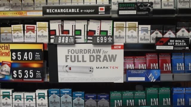 philip morris international inc marlboro brand cigarettes are displayed at gas station in princeton illinois us on wednesday oct 15 close ups and... - marten stock videos and b-roll footage