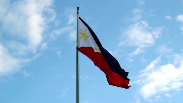 philippine flag against blue sky - philippines flag stock videos & royalty-free footage