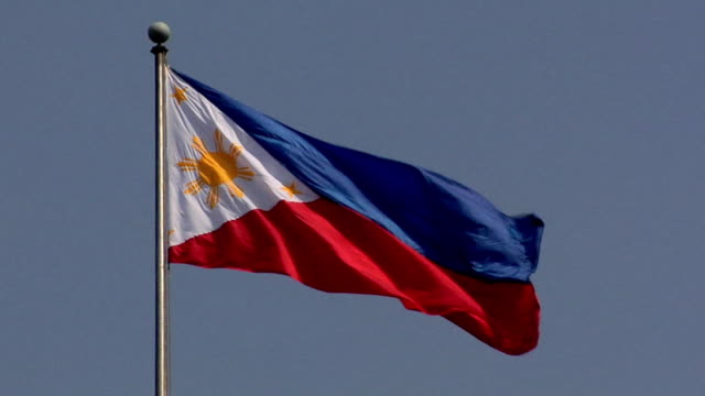ms, philippine flag blowing on wind against clear sky, philippines - philippines flag stock videos & royalty-free footage