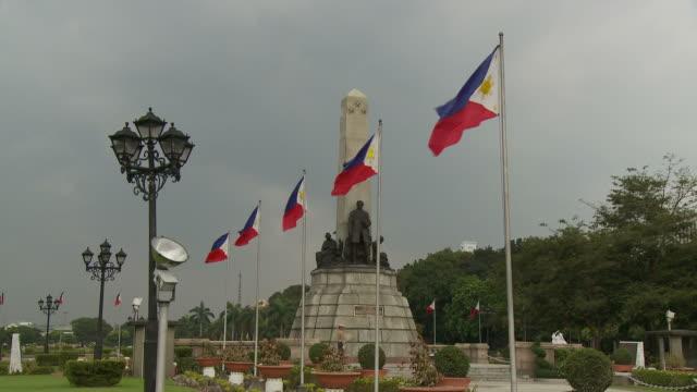 philippine flags at rizal monument in manila philippines - philippines flag stock videos & royalty-free footage
