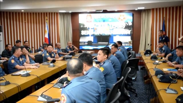 philippine police officers listen to national capital region police office commander major general guillermo eleazar at a send off ceremony at a... - capital region stock videos & royalty-free footage