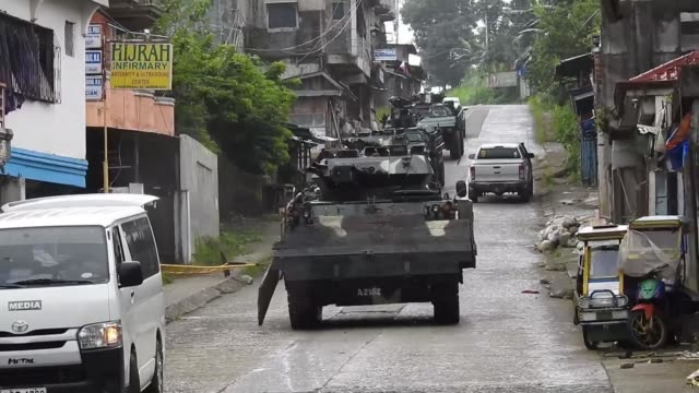 philippine president rodrigo duterte makes a surprise visit to the war torn city of marawi where troops are still engaged in a brutal fight to crush... - philippines stock videos & royalty-free footage